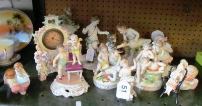 Two porcelain clocks, group of porcelain and bisque figures