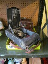 An Eastman Kodak Co. folding camera and a Franke & Heidecke box camera
