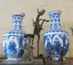 An Ashanti style metal model of a rearing horse and rider and three similar smaller figures, and a