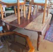 A French mahogany dropleaf table on turned supports with interleaf