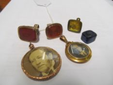A 9ct gold photo pendant, four seals and another photo pendant