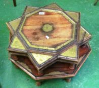 A low eastern octagonal table with brass decoration and a star shaped table