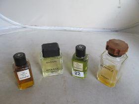 A bottle Chanel No.5 Eau de Toilette, Chanel No.19 Eau de Toilette and two dummy display bottles