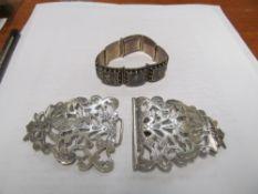 A silver nurses buckle and a Niello bracelet