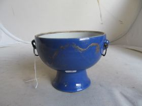 A Chinese blue and gilt bowl with iron handles six character mark to base
