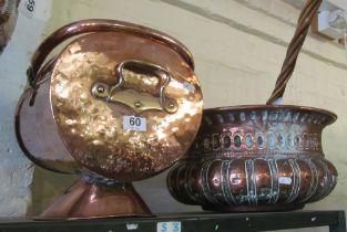 A copper coal bin and copper circular log holder