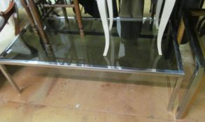 A square glass table and rectangular table