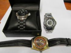 A Guess gent's watch boxed, Charles Raymond gent's watch and an E-Zone gent's watch