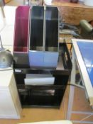A black perspex three tier trolley/table, three filing boxes and a desk light