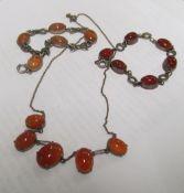 A sterling silver bracelet, orange coloured stones, another silver bracelet and another