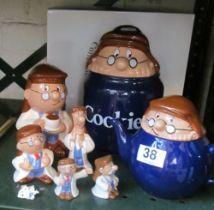 A Tetley Tea cookie jar, teapot, pepper and salt, moneybox and two figures