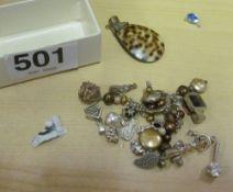 A bag of silver pendants