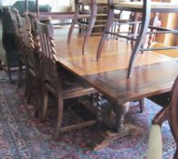 An oak drawleaf table and set of 6 chairs