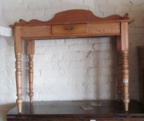 A pine side table with small drawer
