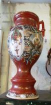A Japanese tall two handled vase iron red ground and wing style pattern
