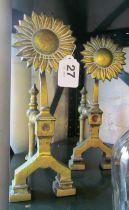 A pair brass firedogs sunflower design