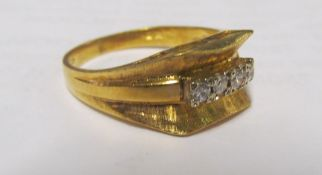 An 18ct gold ring with four small diamonds 5g, size P