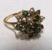 A gold emerald and pearl cluster ring 3.9gms, size Q