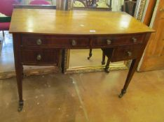 A 19th Century mahogany side table with four drawers on square tapered legs