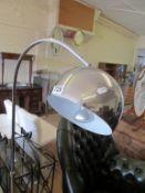 A modern chrome standard lamp