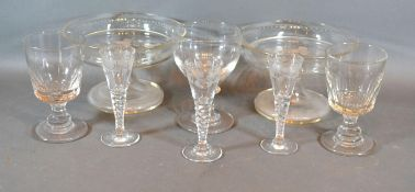 A Pair of Edwardian Glass Comports together with a set of three 19th Century engraved cordial