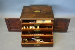 A Silver Plated Canteen of Cutlery housed within a Mahogany Canteen Cabinet of four drawers with