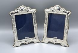 A Pair of London Silver Photograph Frames of Shaped Embossed Form, 21 x 15 cms