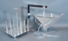 A Silver Plated Teapot in the style of Christopher Dresser together with a four division toast rack
