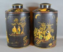 A Pair of Tollware Covered Canisters with chinoiserie decoration upon a black ground and highlighted