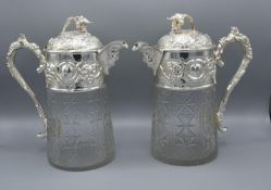 A Pair of Cut Glass and Silver Plated Claret Jugs embossed with Grapevine and with figural head