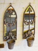 A Pair of Weathered Metal Wall Mirrors of shaped form each with a single planted 64cm by 20cm