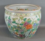A Chinese porcelain Fish Bowl decorated in polychrome enamels 34cm diameter