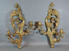A Pair of French Patinated Bronze Wall Sconces of shaped scroll form 49cm long