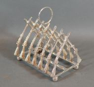 A Silver plated Six Division Toast Rack in the form rifles