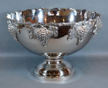 A Silver Plated Punch Bowl decorated with grape vine upon a circular pedestal base 38cm diameter