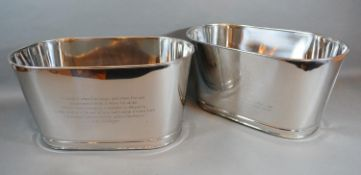 A Pair of Wine Coolers bearing inscription Bollinger and with engraved crest 35cm by 21cm by 18cm
