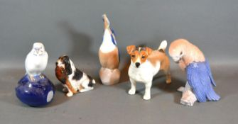 A Beswick Model of a Jack Russell Terrier together with Royal Doulton Model of Dog with Pheasant,