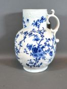 An 18th Century English Large Jug decorated in underglaze blue with birds amongst foliage, 26 cms