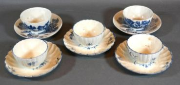 A Pair of First Period Worcester Tea Bowls and Saucers decorated in underglaze blue together with