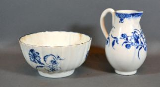 A First Period Worcester Cream Jug together with a similar small bowl