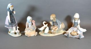 A Lladro Figurine in the form of a Girl Feeding Ducks together with three other similar Lladro