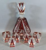 A Bohemian Ruby and Clear Glass Drinking Set comprising Decanter with stopper and six small Glasses