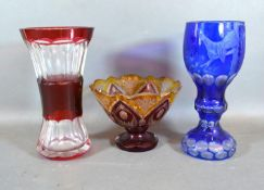 A Bohemian Blue Glass Goblet, 20 cms tall together with a Ruby Glass Vase and a similar pedestal