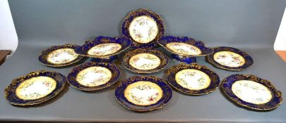 A Hammersley Dessert Service comprising a pair of comports and nine plates all hand painted with