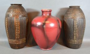 A Pair of Bretby Pottery Vases of oviform with ribbed decoration, 28 cms tall, together with a
