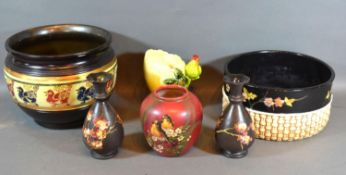 A Bretby Jardiniere together with a similar pair of Bretby vases and three other items of Bretby