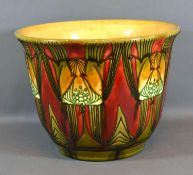 A Minton Secessionist Number 71 Jardiniere with Stylised Decoration upon a red and green ground