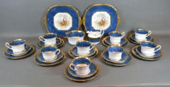A Fenton Porcelain Tea Service comprising nine cups and saucers, nine plates, a pair of dishes,