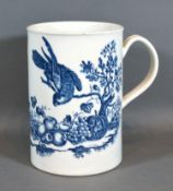 A First Period Worcester Large Mug decorated in underglaze blue with birds and insects amongst fruit