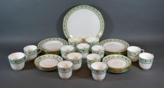 A Mintons Tea and Coffee Service comprising cups, saucers and plates all with a gilt decoration upon